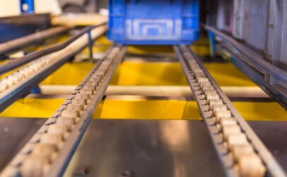 Close up image of rollers used as a material handling solution