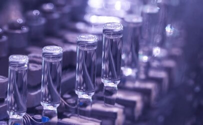 Image of a bottles in a production line setting