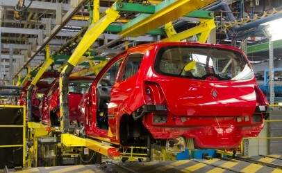 Photo of cars being manufactured on a production line