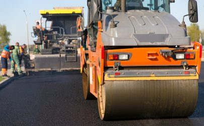 Image of steamroller working on a newly laid road