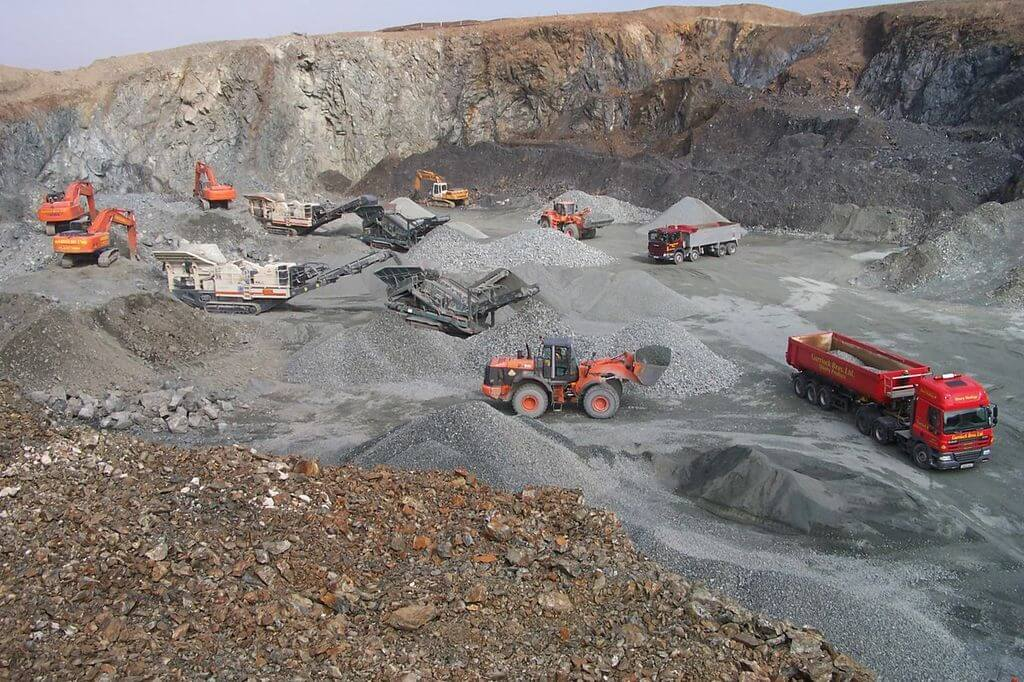 Photo of construction vehicles working in a quarry