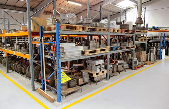 Image of cast moulded products on factory shelving