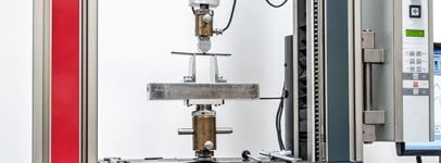 Photo of material sample being tested for strength