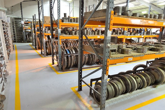 Photo of cast and injection moulds on factory racking